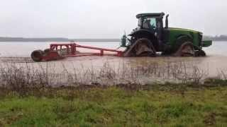 John Deere 8335R on Camoplast CTS track rolling in rice field in Arkansas