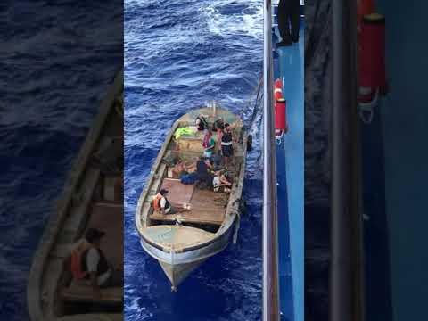 Pitcairn Islanders Unload their Wares onto Oceania Marina