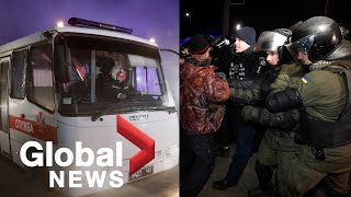 Coronavirus outbreak: Ukrainian police scuffle with protesters as China evacuees arrive