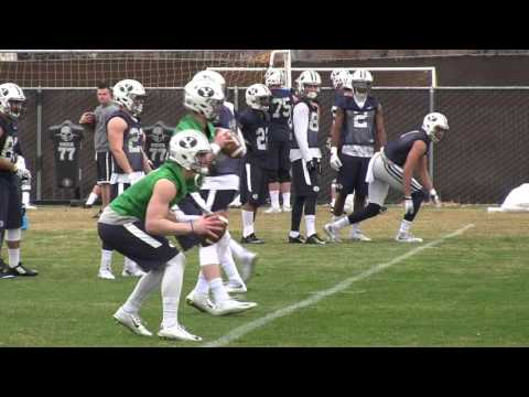 Tanner Mangum and Ty Detmer work together in spring ball