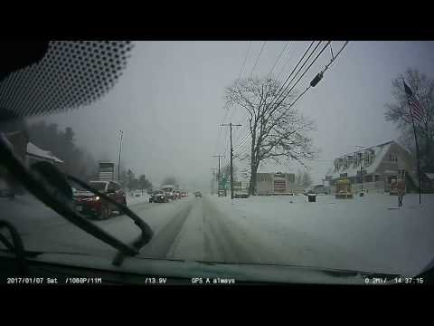 Idiot riding his bike in a snow storm