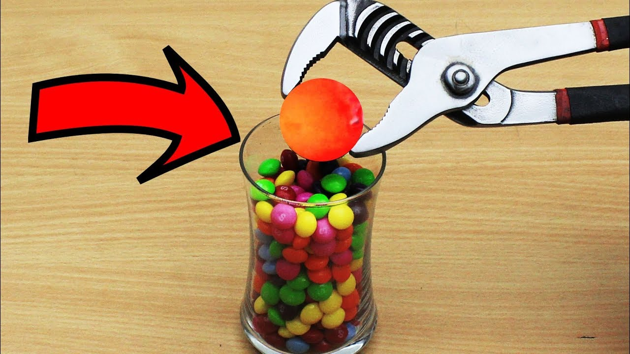EXPERIMENT Glowing 1000 degree METAL BALL vs SKITTLES