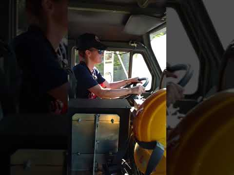 Women Fire Fighter drives big military truck on Florida brush fire