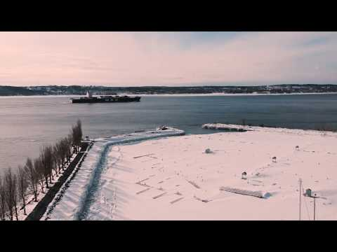 Drone over snowy St. Lawrence River (Quebec)