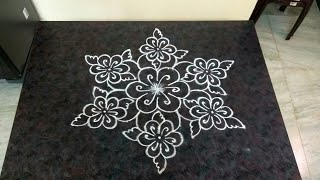 Special poo kolam with 13×7 interlaced dots