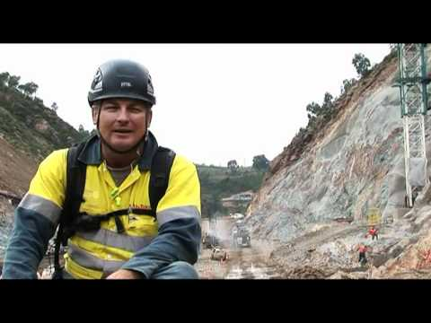 Scaling the Cotter Dam abutment walls - a cleaners tale