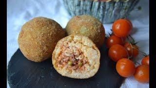 Gli arancini di riso siciliani: gusto e tradizione nel palmo di una mano