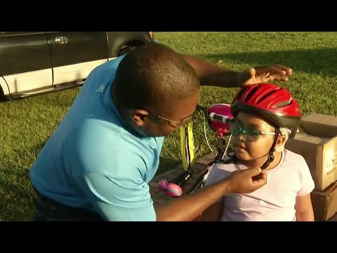 Students receive free helmets on National Bike to School Day
