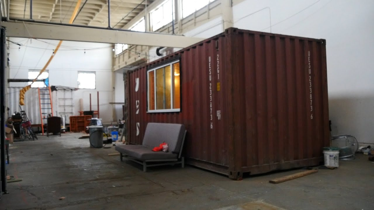 step inside an under-construction shipping container tiny home