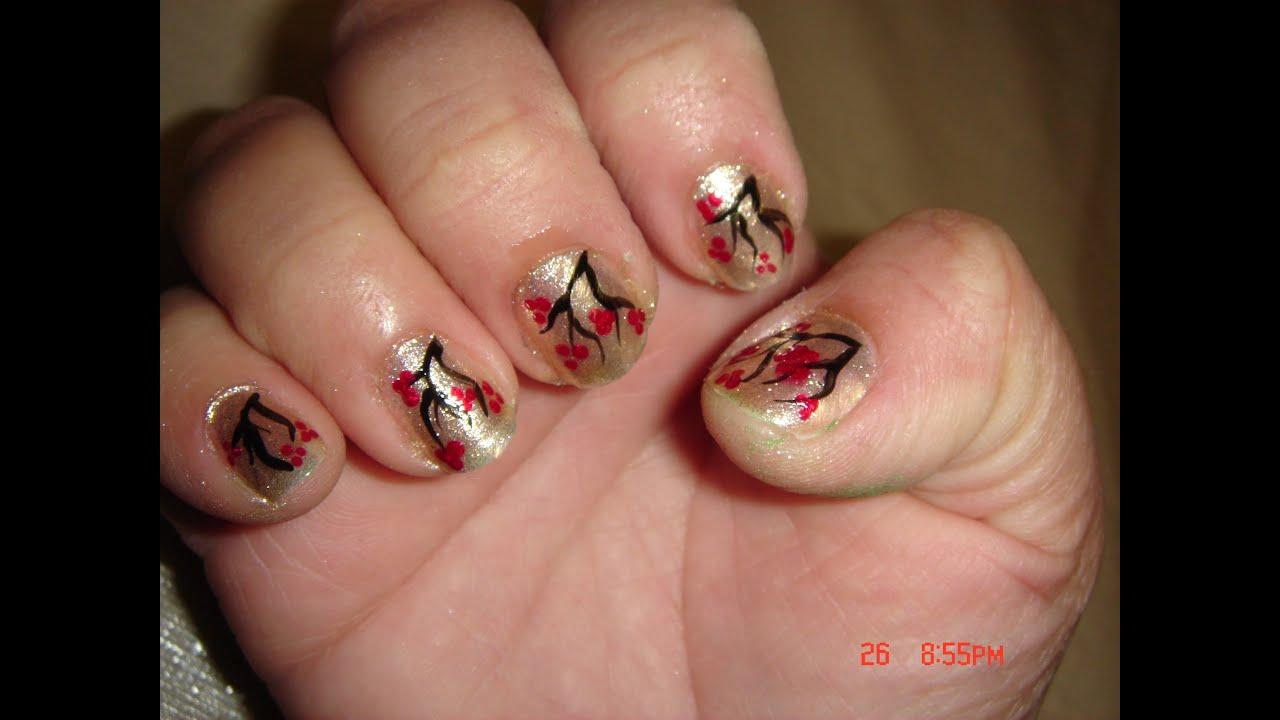 facil diseño de uñas flores rojo y dorado