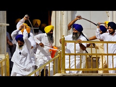 Sword-wielding Sikhs clash at India's Golden Temple...over a mic