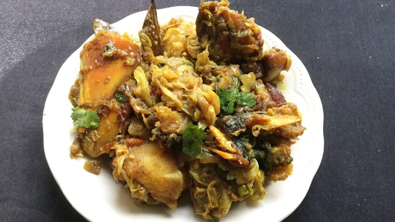 Macher matha diya badhakopi bengali style cabbage with for Fish head recipe