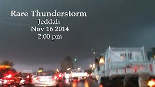 Jeddah, KSA - Rare overhead black rain cloud thunderstorm lightning strong winds heavy downpoar
