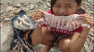 cooking in forest- grilled Pig Intestine on a rock at the river- eating delicious