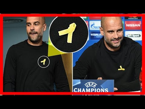 Pep guardiola wears yellow ribbon at manchester city press conference as former barcelona boss show