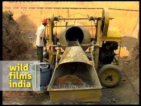 Hydraulic type old concrete mixer machine in use in India