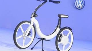 "Electric Bike by Volkswagen Auto China 2010(SUBSCRIBE for daily car videos! http://vid.io/xkQ With Volkswagen ""Think Blue stands for ecological and sustainable mobility. But that is not necessarily a car as ..., 2010-04-30T12:45:18.000Z)"