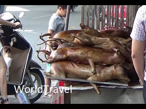 Dog meat being butchered on the streets of Hanoi Vietnam.