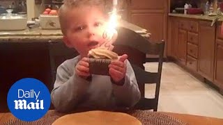 Adorable moment two-year-old boy can't blow out birthday candle