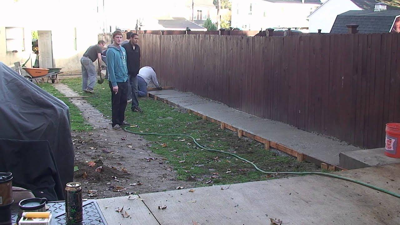 Pouring a concrete sidewalk
