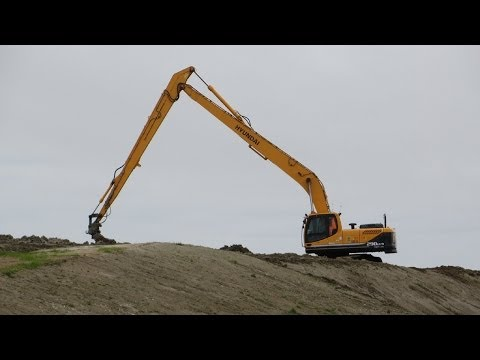 Bagger HYUNDAI 290 LC 9 Long Reach bei Arbeiten am Deich von Büsum - Soeren66