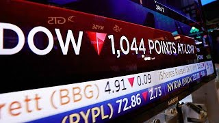 Wall Street: Dow Jones sinks 4 percent in volatile trading