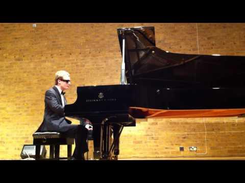 derek paravicini playing funky version of winter wonderland
