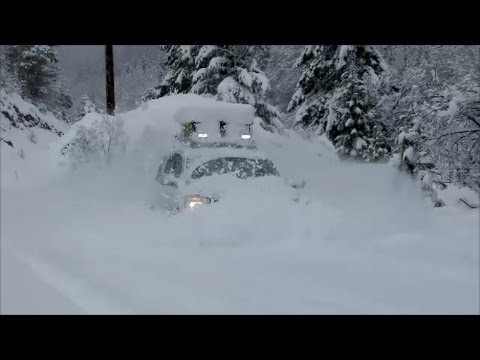 Nissan Armada 4x4 snow play in mountain road. Long version.