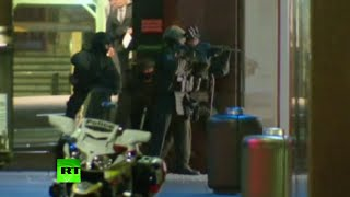 RAW: The moment police storm Sydney hostage site using live rounds & grenades