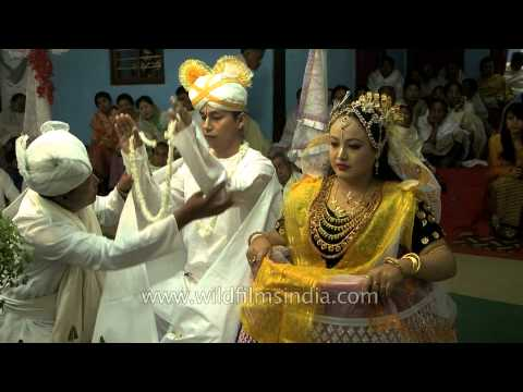 Manipuri bride and groom exchange garlands