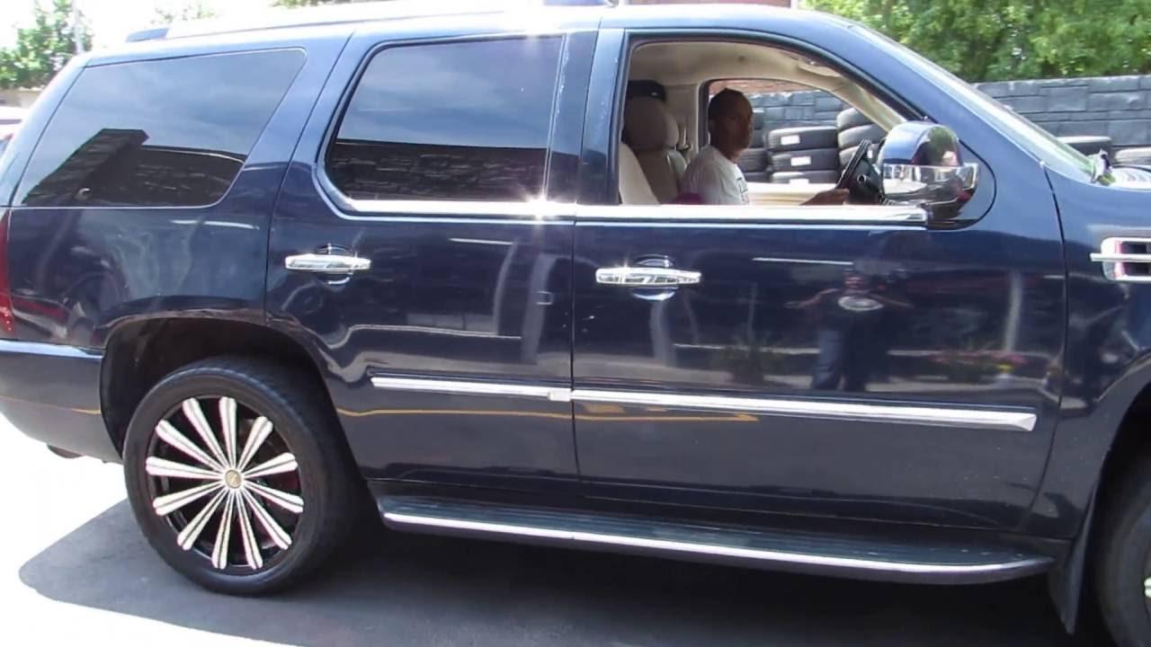 2008 cadillac escalade riding on black 22 inch custom rims tires