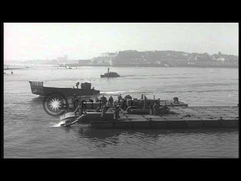 US Rhino barge screws turn at Plymouth harbor, England during World War II. HD Stock Footage