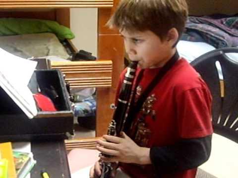 funny boy playing clarinet mp3