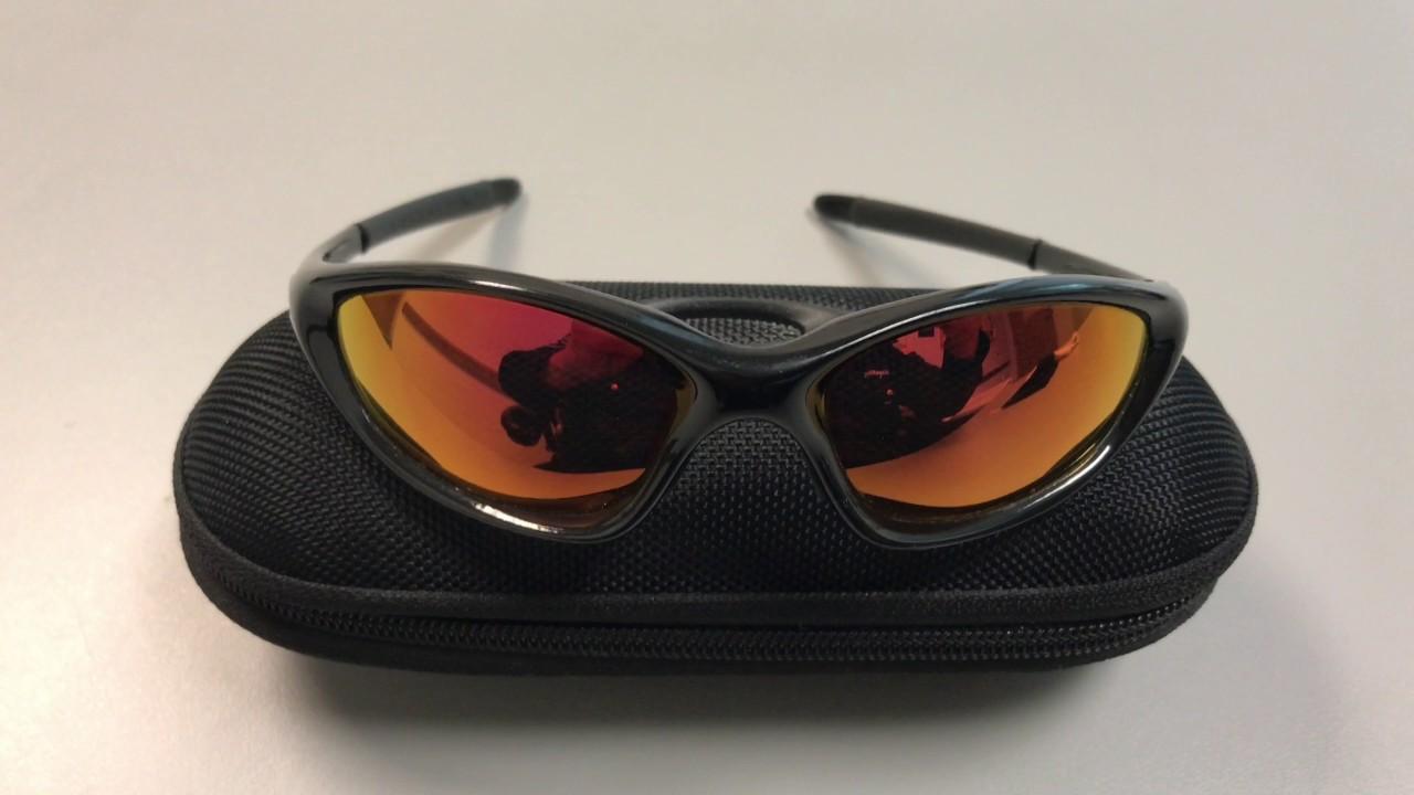 a29a1eaa0f6 Oakley Twenty XX Polarized Sunglasses Fire Iridium - YouTube