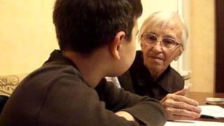Внук с бабушкой делают уроки