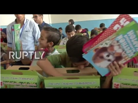 Syria: Russian troops bring colouring kits to Aleppo school children