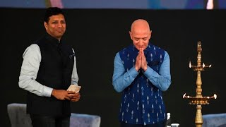 Amazon's Jeff Bezos announces $1 billion investment into India businesses as business owners protest