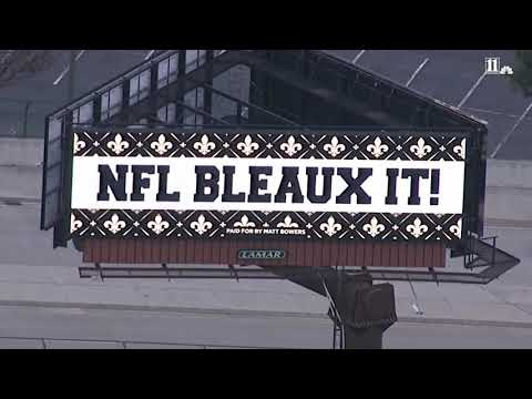 DZL - Saints fan put up negative billboards in Atlanta before the Super Bowl.