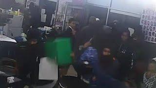 Horrifying moment African gang storm barber shop before mass brawl
