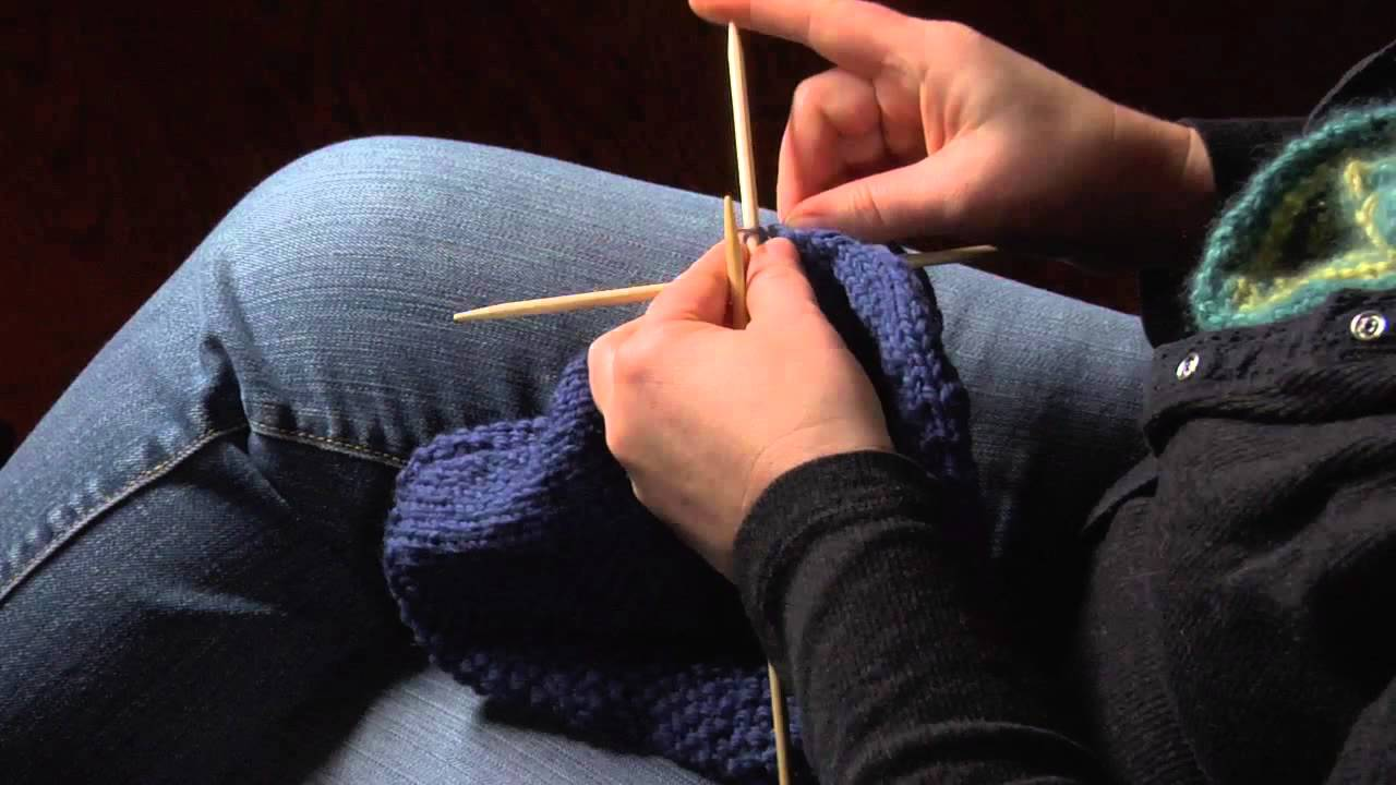 How to Finish a Knitted Hat by Threading Yarn Through the Remaining Stitches ...