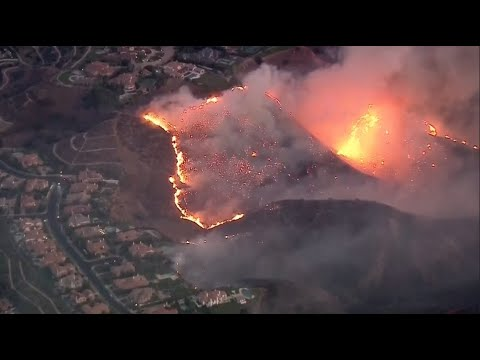 Southern California wildfires encroach upon homes, businesse