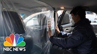 Chinese Ride-Hailing Company Uses Thick Plastic To Keep Coronavirus At Bay | NBC News