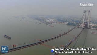 Main cables of China's first road-rail suspension bridge erected