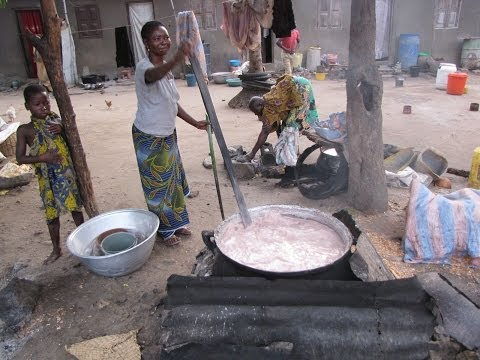 Togo Africa Woman Cooking Up Big Pot of Millet Drink