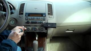 How to Nissan Altima Bose Car Stereo Radio Removal 2005 - 2006 replace repair