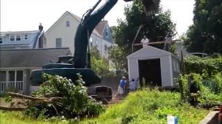 Large shed lifted by backhoe 07/28/15