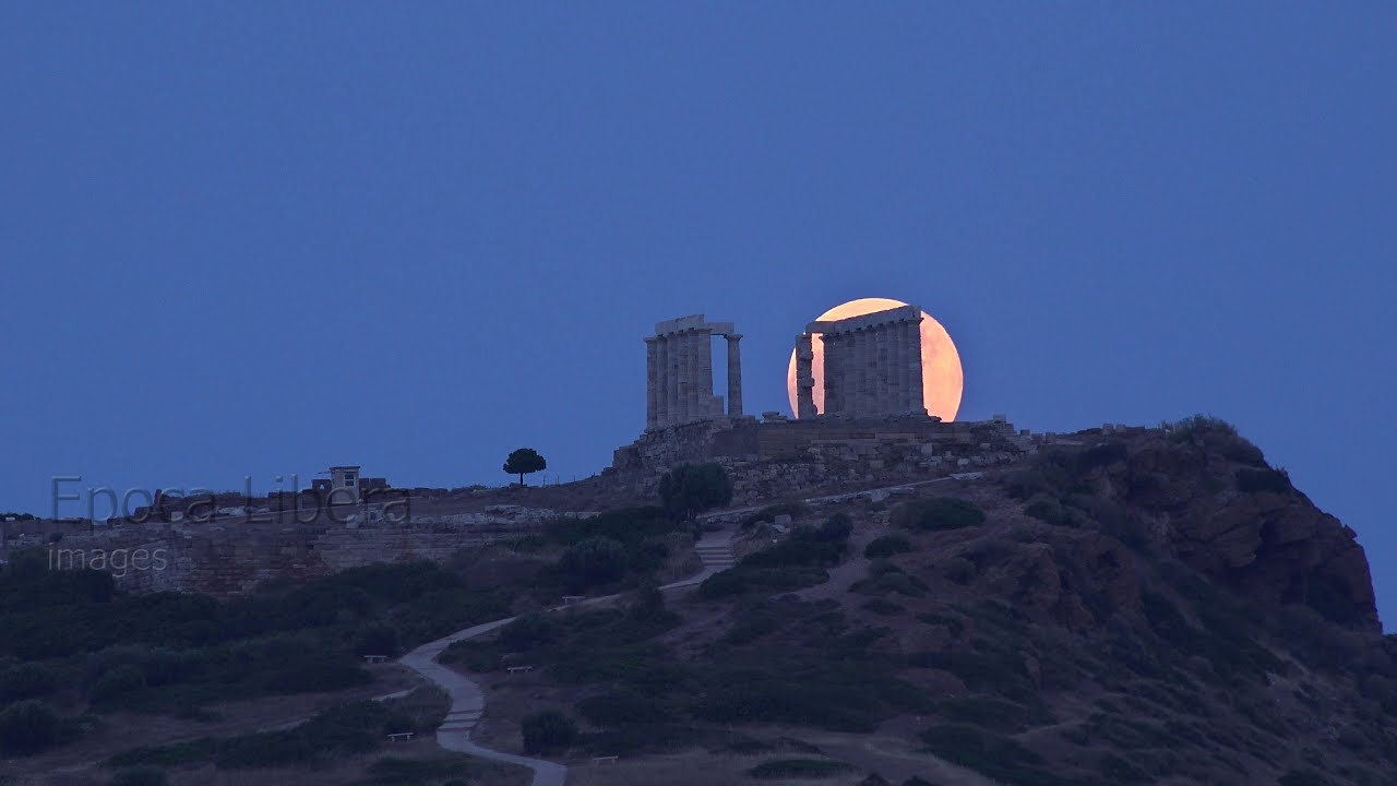 4K Timelapse: Full Strawberry Moon rising above Ancient Temple in Greece