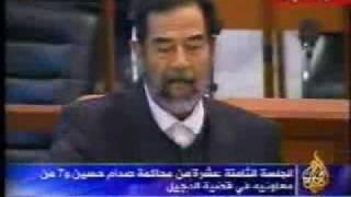 صدام و الملحمه داخل قاعة المحكمه6