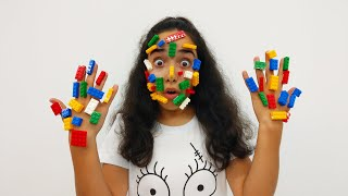 The face of Asya's is covered with Lego