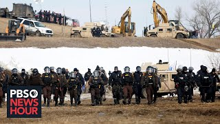 News Wrap: Judge halts Dakota Access Pipeline pending environmental review